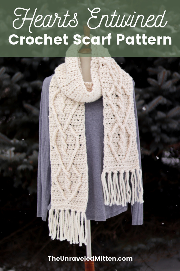 This trendy chunky crochet cable scarf features a twisted heart cable pattern on each end. Perfect for Valentine's Day!