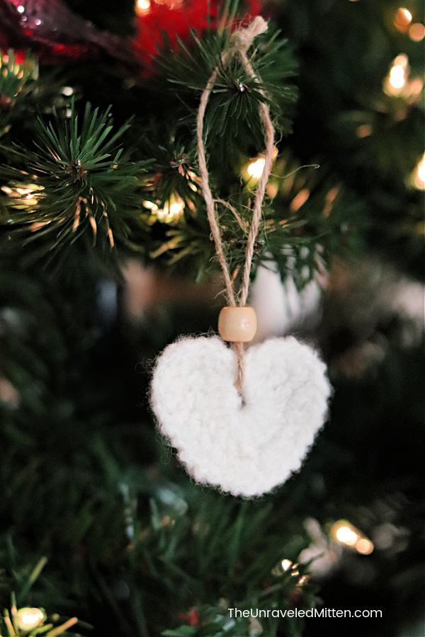 Felted Crochet Heart Ornament Hanging on a Christmas Tree