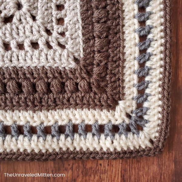 Textured crochet 12 inch granny square in neutral colors